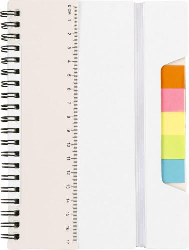 Spiralbunden anteckningsbok med linjal och notislappar